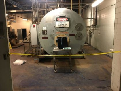 Removing friable components of hot water boiler