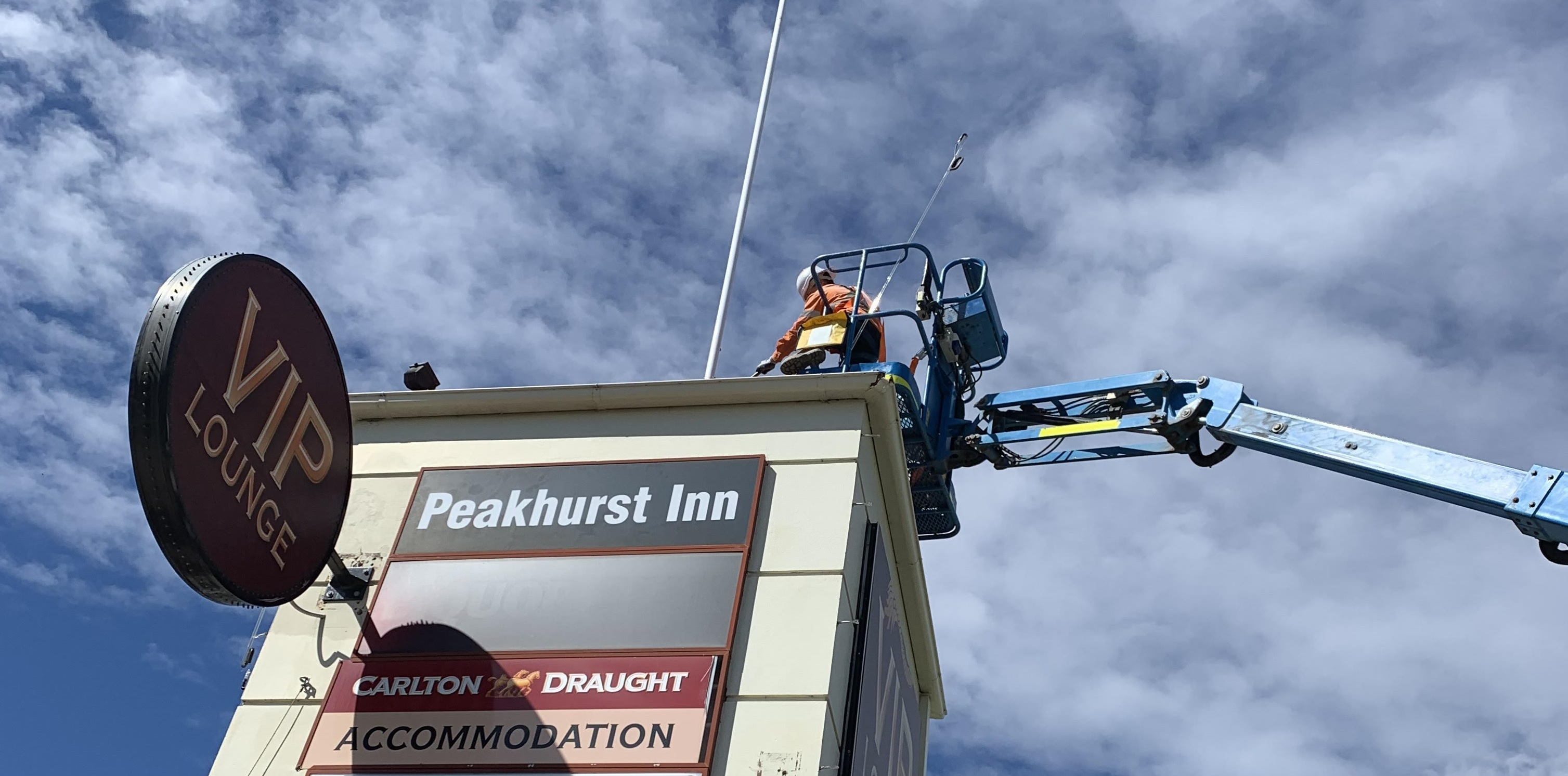 Demolition of a tower roof structure and signage removal in Peakhurst